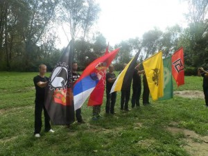 International meeting of nationalist organizations in summer 2014 (first person form left holds a flag of Warsaw AN group
